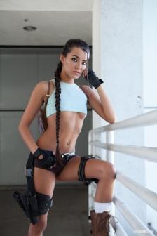 Joanie Brosas leaning on rail Tomb Raider cosplay