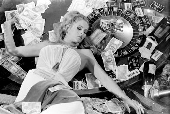 Actress Ursula Andress posing on a roulette in the 1967 spy spoof 'Casino Royale' in which she plays Vesper Lynd.